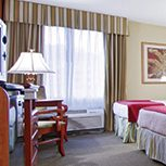 Custom digital drapes and bed skirts in a Best Western hotel chain.